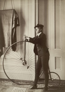 Frances_Benjamin_Johnston,_Self-portrait_with_false_moustache_and_penny-farthing